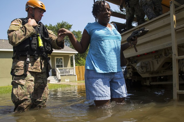 U.S. Army Sgt. Chase Smith helps a trapped flood victim in Orange, Texas, Sept. 4, 2017. The U.S. Military and relief agencies continue to assist in aiding those affected by Hurricane Harvey.