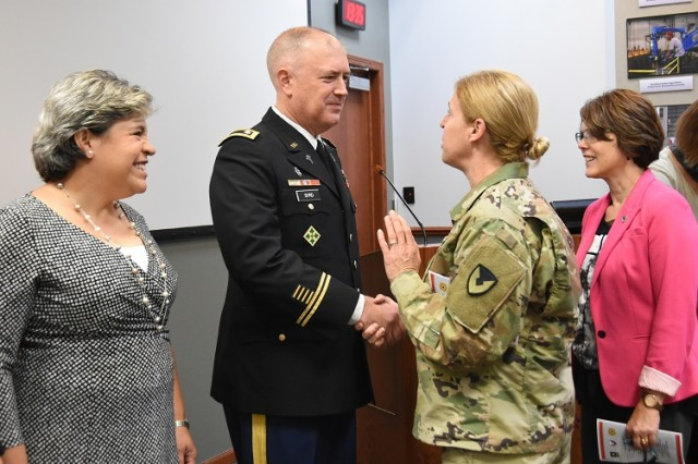 Lt. Col. and Mrs. Byrd are congratulated by Col. Heidi Hoyle, Commander of Joint Munitions Command, and Ms. Melanie Johnson, Deputy to the Commander. (Photo by Nathan Joyce, JMC Public and Congressional Affairs.)