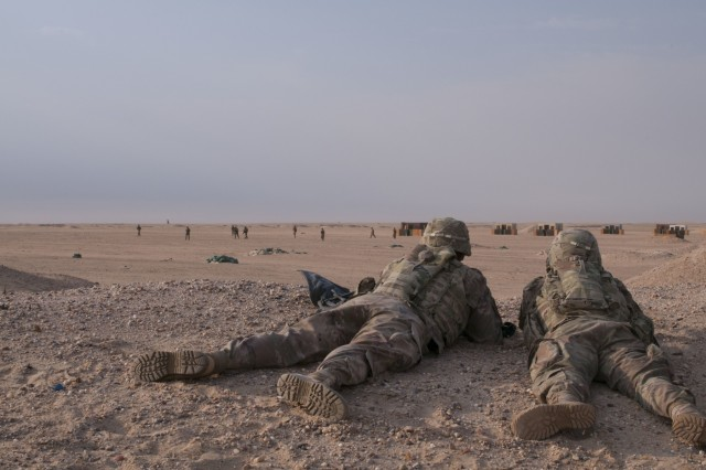 Soldiers with an automatic weapons team in C Company, 1st Battalion, 12th Cavalry Regiment, lift fire during a training exercise at Udari Range Complex near Camp Buehring, Kuwait, Oct. 17, 2017. The infantry unit conducted a platoon mounted and dismounted assault on an objective, an exercise that better prepares it to certify for future deployments after it returns to the U.S.