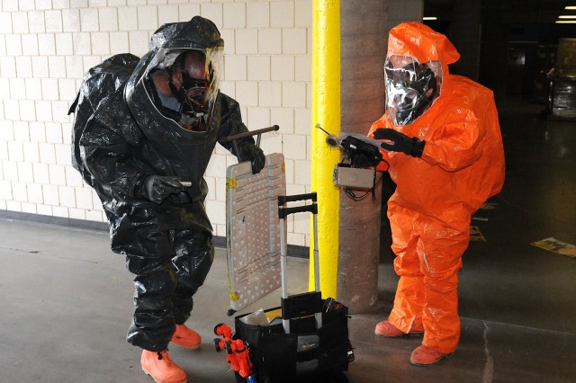 U.S. Army 2nd Lt. Michael Wollman, left, and Staff Sgt. Kelley Trebesch, both survey team members with the 82nd Civil Support Team, South Dakota National Guard, prepare to conduct sampling of an unidentified substance during a training exercise at the Rushmore Plaza Civic Center in Rapid City, S.D., Oct. 12, 2017. The 82nd CST conducts numerous exercises every year to maintain their preparedness level for responding to chemical, biological, radiological or nuclear threats.