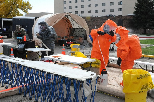 Members of the 82nd Civil Support Team, South Dakota National Guard, train on decontamination procedures during a training exercise at the Rushmore Plaza Civic Center in Rapid City, S.D., Oct. 12, 2017. The 82nd CST conducts numerous exercises every year to maintain their preparedness level for responding to chemical, biological, radiological or nuclear threats.