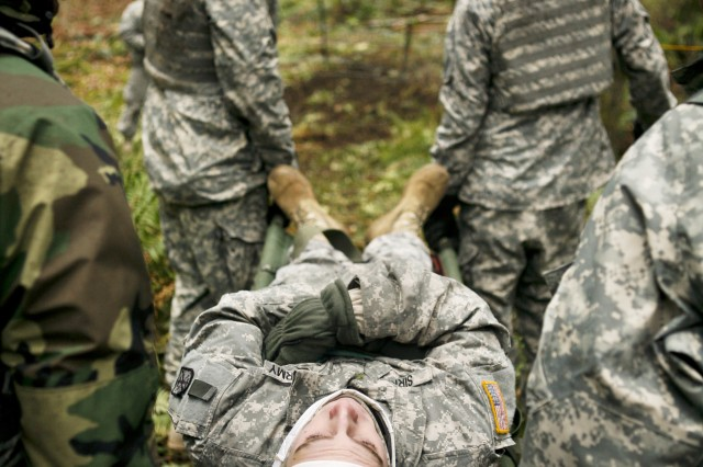 Soldiers train for casualty evacuation.