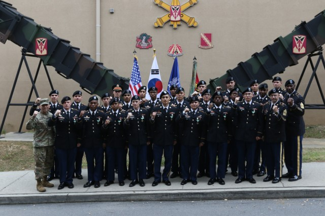 The winning crews of the 35th Air Defense Artillery Brigade Missile Defender of the Year competition take a picture with the 35th ADA Brigade command team, Col. Rick Wright and Command Sgt. Maj. Eric McCray, Oct. 26, 2017 in front of the brigade headquarters at Osan Air Base, South Korea. Every fall, the top air defense crews from the Korean Peninsula compete in a series of events to claim the title of Missile Defender of the Year.