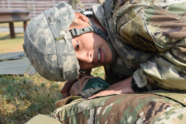 Sgt. Luiz Sanchezdenova of 6-52 Air Defense Artillery Battalion listens for signs of breathing and observes the rise and fall of the training mannequin's chest during the medical lane of the 35th Air Defense Artillery Brigade Missile Defender of the Year competition Oct. 25, 2017 at Osan Air Base, South Korea. Every fall, the top air defense crews from the Korean Peninsula compete in a series of events to claim the title of Missile Defender of the Year.