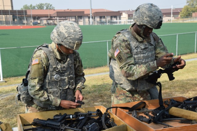 Sgt. Kindal Holeman and Pfc. Brandi Brown, both from 6-52 Air Defense Artillery Battalion, reassemble three different types of weapons during the 35th Air Defense Artillery Brigade Missile Defender of the Year competition Oct. 25, 2017 at Osan Air Base, South Korea. Every fall, the top air defense crews from the Korean Peninsula compete in a series of events to claim the title of Missile Defender of the Year.
