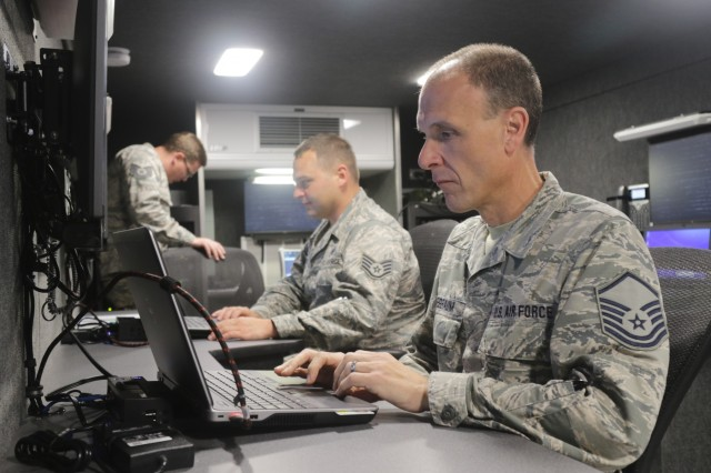 Master Sgt. William K. Kriegbaum, Arkansas Air National Guard, monitors a video stream in a communications trailer he helped design during Southern Strike 2018 at Gulfport's Combat Readiness Training Center - Battlefield Airman Center. Kriegbaum's shared his intimate knowledge of the trailer's capabilities while working with the Mississippi Air National Guard during the joint exercise. (U.S. Army National Guard photo by Staff Sgt. Scott Tynes)