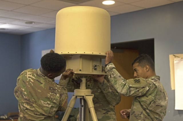 Soldiers from the 1st Battalion, 28th Infantry Regiment Task Force, dismantle a Mobile Directional Antenna System during a One System Remote Video Terminal course in Fort Benning, Ga., Oct. 26, 2017. Task Force 1-28 received the training to support the 1st Security Force Assistance Brigade as a security force element. (U.S. Army photo by Pfc. Zoe Garbarino, 50th Public Affairs Detachment, 3rd Infantry Division)