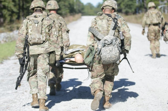 Soldiers with the 815th Brigade Engineer Battalion, 1st Security Force Assistance Brigade transport the injured during medical evacuation training at Fort Benning, Georgia, Oct. 24, 2017.