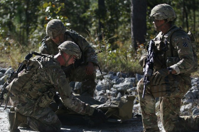 Soldiers with the 815th Brigade Engineer Battalion, 1st Security Force Assistance Brigade perform basic first aid during medical evacuation training at Fort Benning, Georgia, Oct. 24, 2017.