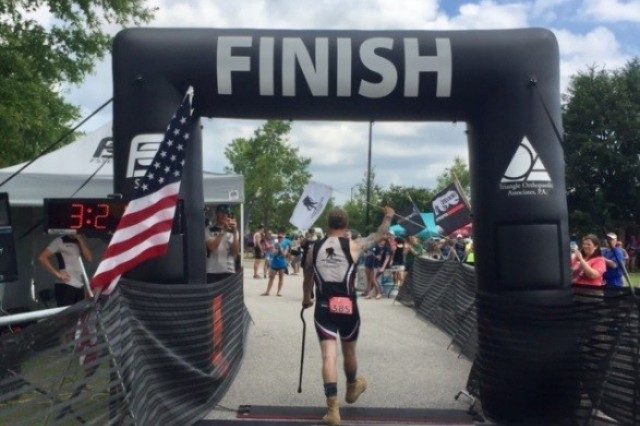 "SGT Mark Green, of the FT Bragg Adaptive Reconditioning Program reaches the finish line of the Three Little Pigs Triathlon in Smithfield NC, despite not being ""solid"" on his feet."