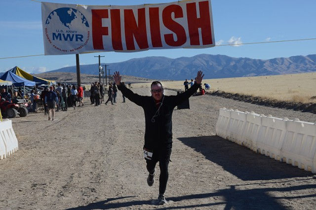 A 10K competitor crosses the finish line at the Oct. 21, 2017 Dugway Trail & Ultra Run event. Begun in 2013 with 35 runners, the 2017 event had 128 runners from military and civilian life. The ultra run at Dugway Proving Ground, Utah, is expected to continue growing as people learn of the excellent, challenging course, scenery, and opportunity to enter an installation seldom seem by the public. Photo by Al Vogel, Dugway Public Affairs.