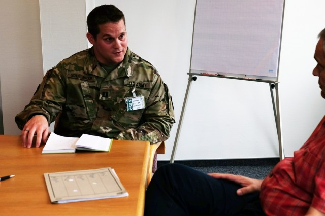 Capt. William Schlotzhauer, 457th Civil Affairs Battalion 361st Civil Affairs Brigade, civil affairs officer meets with a local mayor, Oct. 25, as part of an exercise scenario for Joint Cooperation 2017, the largest multinational civil-military exercise in Europe. The exercise includes more than 140 participants from 23 NATO member nations.