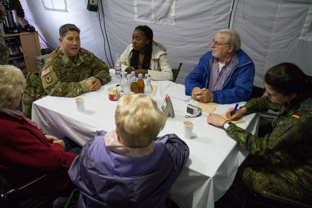 Sgt. 1st Class Mark Korte (far left), civil affairs non-commissioned officer with 457th Civil Affairs battalion, 361st Civil Affairs Brigade, addresses a volunteer role-player's concerns during Joint Cooperation 2017 (JC17) in Dorverden, Germany, Oct. 26. JC17 is the largest multinational Civil-Military Cooperation (CIMIC) exercise within NATO that specifically tests CIMIC core tasks on an international scale (U.S. Army Reserve photo by Capt. Jeku Arce, 221st Public Affairs Detachment).