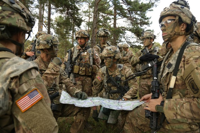 "U.S. Soldiers of the 54th Brigade Engineer Battalion and Italian soldiers of the 5th Battalion, 186th Paratroopers Regiment ""Folgore"" discuss mission objectives while conducting a leader's reconnaissance during exercise Swift Response 17 at the U.S. Army's Joint Multinational Readiness Center (JMRC) in Hohenfels, Germany, Oct. 12, 2017. Exercises such as this help the Army maintain readiness."
