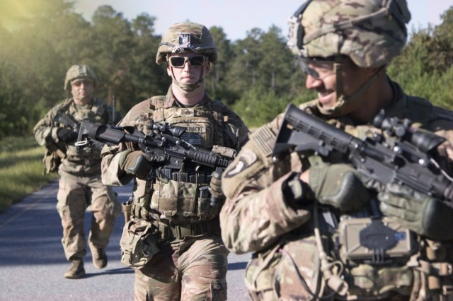 Soldiers assigned to 1st Squadron, 38th Cavalry Regiment, 1st Security Force Assistance Brigade, conduct a foot patrol during a combat advisory team competition at Davis Range on Fort Benning, Ga., Oct. 24, 2017. They are the Army's first brigade purposefully built to help combatant commanders accomplish theater security objectives by training, advising, assisting, accompanying and enabling allied and partnered indigenous security forces. Soldiers interested in joining SFAB should contact their branch manager.