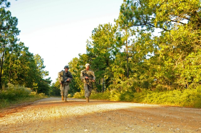Two medics from the 82nd Airborne Division approach the finish line of a 12-mile foot march Oct. 8 on Fort Bragg, N.C. The foot march was the culminating event of the All American Best Medic Competition, which evaluates the medics' tactical and technical proficiency in a variety of scenarios. The winning team will go on to compete in the Army-wide competition next month at Fort Sam Houston, Texas.