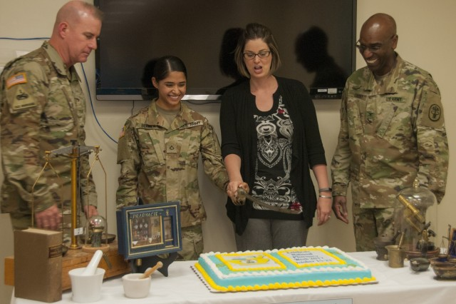 (From Left) Col. Erik Rude, commander, William Beaumont Army Medical Center, Pfc. Rosalinda Bermea, Dr. Abigail Strate and Col. Stacey Causey, chief, Department of Pharmacy, participate in a cake cutting during WBAMC's National Pharmacy Week celebration, Oct. 18.