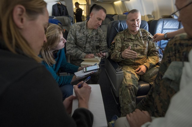 Army Command Sgt. Maj. John W. Troxell, the senior enlisted advisor to the chairman of the Joint Chiefs of Staff, speaks to reporters en route to Washington, D.C., after departing Hawaii, Oct. 30, 2017.