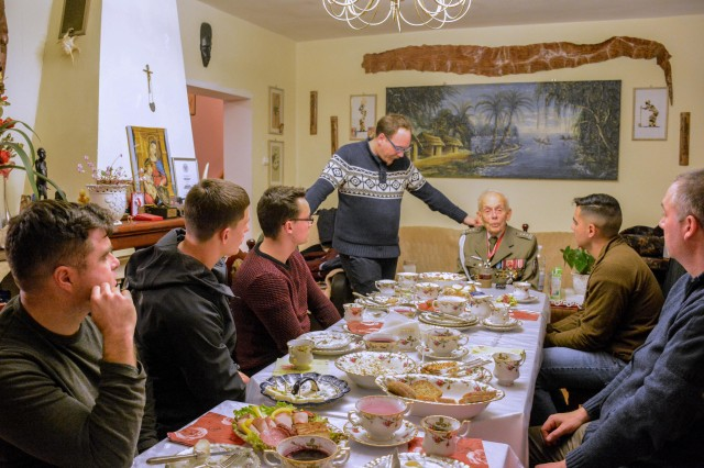 Col. Tadeusz Bie�kowicz, a Polish Army WWII veteran, welcomes a group of soldiers from the Battle Group Poland into his home to celebrate his name-day and share stories from the war, Oct. 28, 2017. Bie�kowicz is a recipient of the War Order of Virtuti Military, Poland's highest military decoration for heroism and bravery during war.