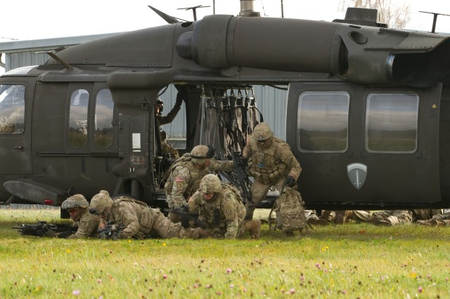Soldiers assigned to Nemesis Troop, 4th Squadron, 2d Cavalry Regiment practice exiting a UH-60 Black Hawk helicopter during an air assault in support of a counter reconnaissance training exercise Oct. 26, 2017 in the Grafenwoehr Training Area, Germany. Alpha Company, 214th General Support Aviation Battalion, 12th Combat Aviation Brigade flew in the helicopters to support the training.