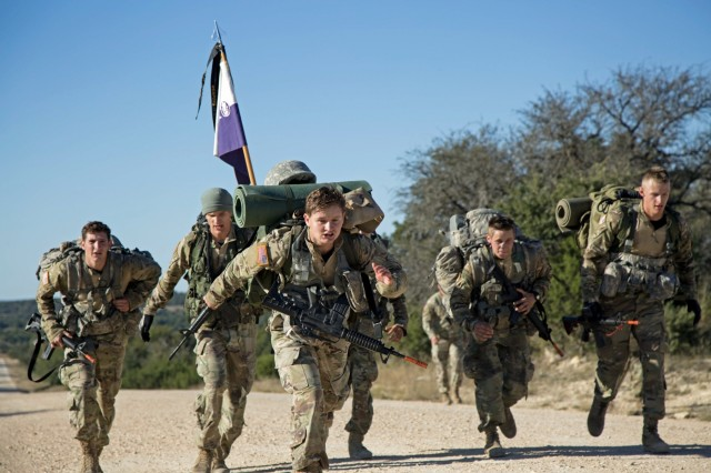 Tarleton State University cadets cross the finish line during the 10-mile ruck march event at the end of the Ranger Challenge competition held at Fort Hood, Texas, Oct. 29, 2017. Thirteen teams of nine cadets, including two Tarleton State teams, competed in the weekend-long competition.