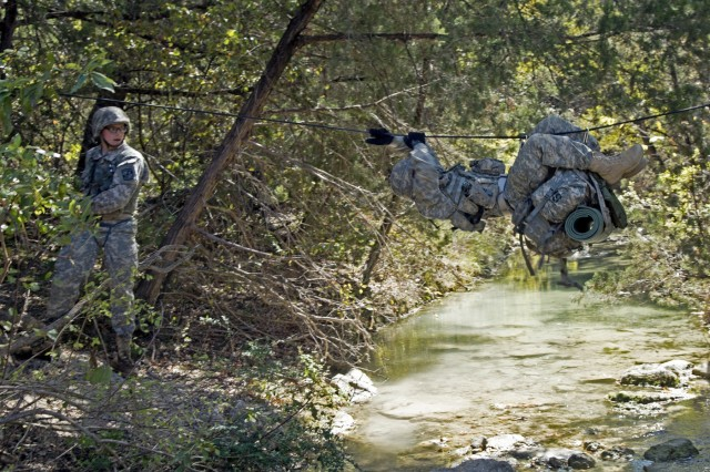 Baylor University cadets cross a stream during the one-rope bridge lane during the warrior task event of the Ranger Challenge competition held at Fort Hood, Texas, Oct. 28, 2017.
