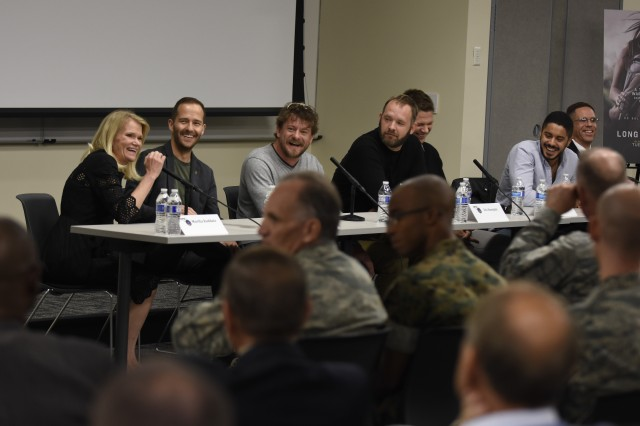 Martha Raddatz, left, author of The Long Road Home, participates in a panel discussion with members of the cast and crew of a miniseries with the same name at the Defense Information School on Fort Meade, Md., Oct. 26, 2017. Iraq War veterans Eric Bourquin and Aaron Fowler, who served as production consultants for the show and were involved in the Black Sunday ambush, also answered questions.
