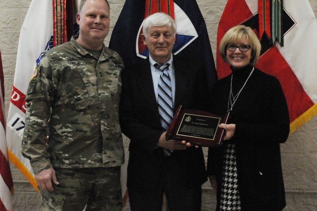 Maj. Gen. Duane A. Gamble, left, commander, Army Sustainment Command and Mary Ann Wicks, right, program specialist, present Dr. Paul Needham with a plaque in appreciation for his presentation, during a resiliency event at Heritage Hall, held at Rock Island Arsenal, Oct. 31.