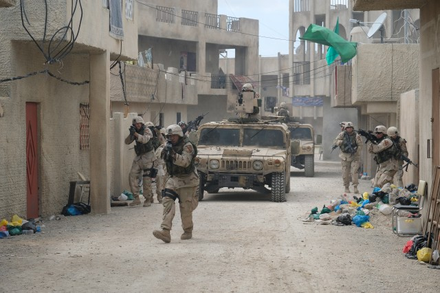 Cast members of The Long Road Home miniseries perform a scene inside a fabricated Middle Eastern town at Fort Hood, Texas. The structures were made to resemble portions of Sadr City, a neighborhood in Baghdad where 1st Cavalry Division Soldiers were ambushed in April 2004.