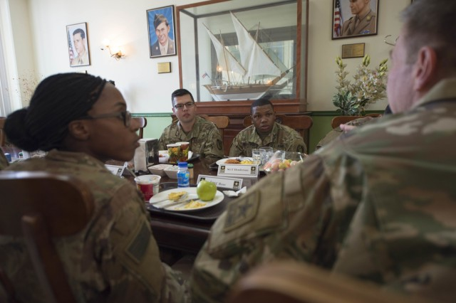 Specialist Hector Vaca, Jr., a Soldier with Area Support Group - Kuwait, asks a question of the 36th Vice Chief of Staff of the Army, Gen. James C. McConville, during the general's visit to Camp Arifjan, Kuwait, Oct. 16, 2017. Vaca and eleven other Soldiers were hand-picked by their units to have a conversation with the Army's second-most senior leader. (Photo: Sgt. David L. Nye, U.S. Army Central Command)