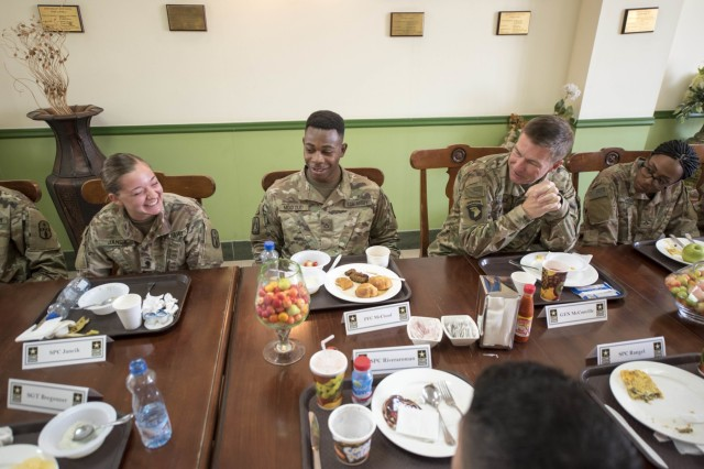 Specialist Lilian Jancik, 1st Theater Support Command, laughs at a joke made by the 36th Vice Chief of Staff of the Army, Gen. James C. McConville, during a breakfast, Oct. 16, 2017, on Camp Arifjan, Kuwait. McConville ate with selected Soldiers and asked them what changes they would make if they were the vice chief of staff. (Photo: Sgt. David L. Nye, U.S. Army Central Command)