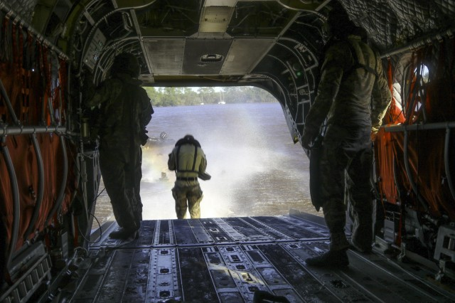 A Soldier jumps out of a CH-47 Chinook assigned to the 1st Battalion, 111th Aviation Regiment during Southern Strike 18 Oct. 25, 2017, in Gulfport, Mississippi. The 1-111th provides units with air support training and transportation for various exercises, including the helocast missions.