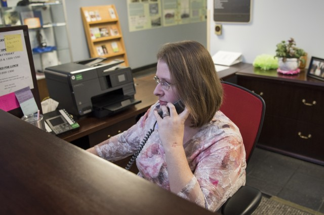 Renae Templeton, a communications specialist in the South Carolina Military Department, answers calls at the Joint Force Headquarters building, South Carolina National Guard, Columbia, South Carolina, Oct. 11, 2017.