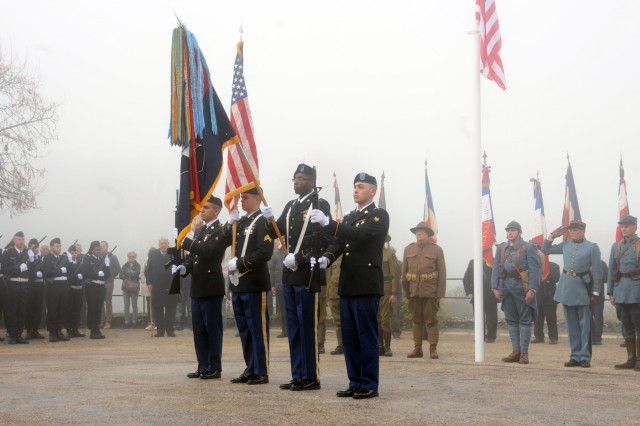 The color guard from 66th Military Intelligence Brigade presents the 2nd Infantry Division Colors for patrons to salute during the 100-year celebration of the units' existence in a ceremony, Oct. 26.