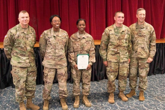 Soldiers from 6th Battalion, 1st Security Force Assistance Brigade and the1st SFAB command group take a group photo during a promotion ceremony Nov. 1, 2017 at Fort Benning, Georgia. The Soldiers were automatically promoted under the Army's new SFAB promotion policy after graduating from the Military Advisor Training Academy. The MATA course provides realistic training to foreign security force advisors whose mission is to train, advise, assist, accompany and enable allied and partner forces. Soldiers interested in volunteering for the 1st SFAB should contact their branch manager. (U.S. Army photo by Staff Sgt. Vincent Byrd, 50th Public Affairs Detachment, 3rd Infantry Division/Released)