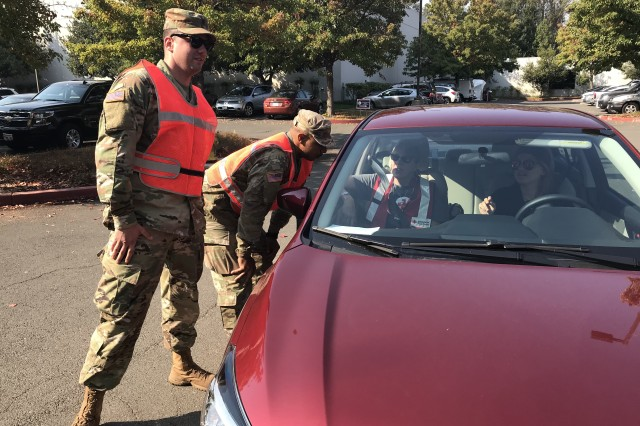 California Army National Guardsmen from the 330th Military Police Company control a traffic point in October 2017 at the Local Assistance Center in Napa, California, during the Northern California wildfires.