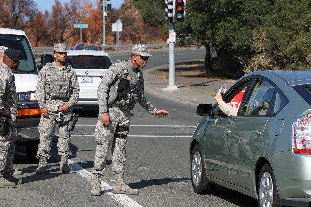Airman 1st Class Danelle Perey of the 146th Security Forces Squadron, 146th Airlift Wing (Channel Islands), California Air National Guard, checks identification of a Santa Rosa, California, resident prior to entering a fire-damaged district Nov. 2 during a recovery stage of the Northern California wildfires. Army and Air Guardsmen were mainstays of recovery efforts, monitoring traffic and entry points as well as providing security at various evacuation sites.