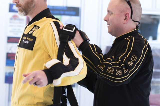 JJ Pinter, executive director of an organization that connects veterans with athletic competitions, gets his straps adjusted in preparation for a tandem jump with the Army Golden Knights. Pinter was among 16 distinguished veterans and community leaders invited to participate in a demonstration jump by Army Recruiting Command Nov. 1, 2017 in Perris, Calif.