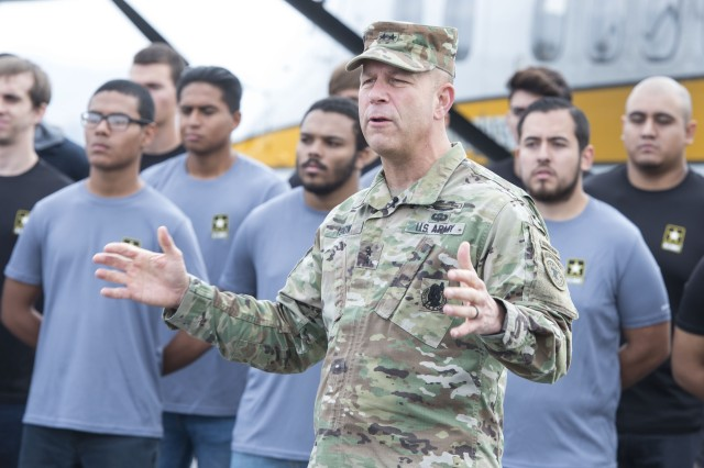Maj. Gen. Jeffrey Snow, commander of the Army's Recruiting Command, speaks to media members before a swearing in ceremony at the Skydive Perris tandem camp Nov. 1, 2017.