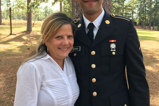 Pvt. Ramon Nazario poses with his mother Katherine Berrios-Borges after his graduation from Basic Combat Training Nov. 2. Berrios-Borges was helped by the mother of her son's battle buddy to fly to see her son graduate.