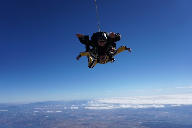 Sgt. 1st Class Tom Melton, Army Golden Knights tandem coordinator, takes a participant of the U.S. Army Recruiting Command's tandem camp on a jump in Perris, Calif., Nov. 1, 2017.