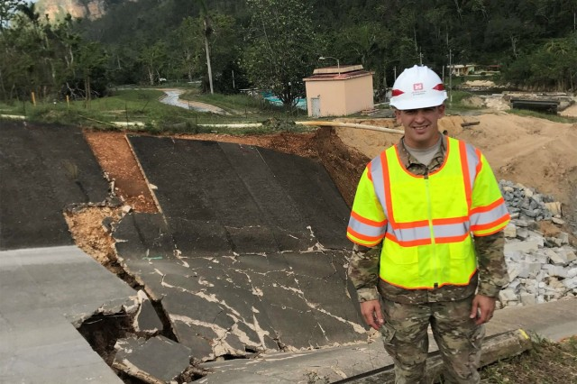 Capt. Kenneth Skillman IV, action officer for the Guajataca Dam, San Sebastian, Puerto Rico in front of the damaged emergency spillway. Skillman graduated from the Engineers Captain Career Course, October 6 at Fort Leonard Wood, Mo.