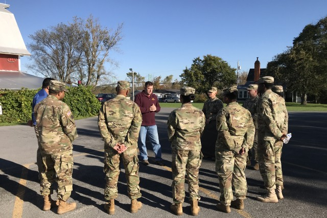Retired Maj. Stephen Conaway shares his memories as a former contingency contracting officer with members of the 925th Contracting Battalion and Mission and Installation Contracting Command during a presentation and tour of his winery Oct. 18 in Alexandria Bay, New York.