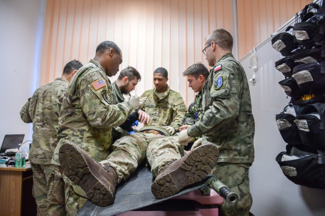 A group of medical soldiers from the 3rd Squadron, 2d Cavalry Regiment, the Polish 15th Mechanized Brigade, the United Kingdom's Light Dragoons and the Romanian Army's Ground Base Air Defense Black Bats conduct joint medical training, Oct. 31, 2017. The purpose of the training was to codify international standard operating procedures related to mass casualty medical evacuations and further the interoperability between the United States and its allied forces supporting NATO's enhanced Forward Presence initiative.