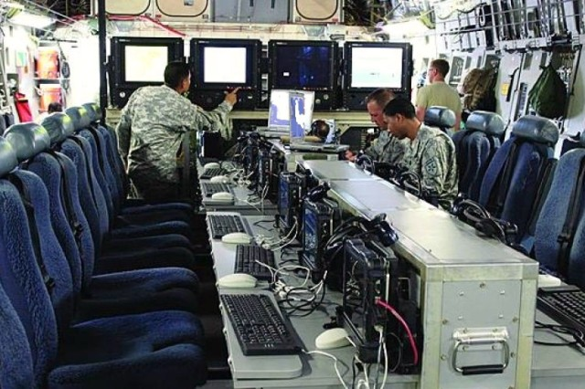As part of the Enroute Mission Command capability suite, the Command and Staff Palletized Airborne Node, or CASPAN, is a 12-seat palletized conference workspace flanked by large-screen monitors, which can be rolled on and off the planes to provide generals and higher ranked staff with their own airborne mission planning node.