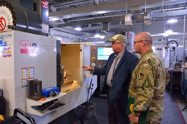 Hudson Valley Community College Manufacturing Technical Systems Professor David Larkin, left, showing Arsenal Commander Col. Joseph Morrow some of the machines Morrow's apprentices use at the college during their course of instruction.