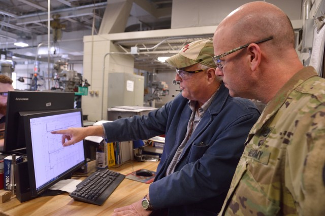 Hudson Valley Community College Professor David Larkin, left, showing Arsenal Commander Col. Joseph Morrow some of the layout of the new Advance Manufacturing Skills center that the college will open in 2019.