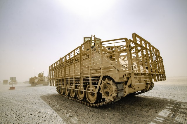 A convoy of tanks moves from one operational grid to another during an issue exercise for Army Prepositioned Stocks-5 equipment led by the Army Field Support Battalion-Kuwait, 401st Army Field Support Brigade at Camp Arifjan, Kuwait, June 21. The exercise spanned three days and occurred during a substantial sand storm. (U.S. Army Photo by Justin Graff, 401st AFSB Public Affairs)