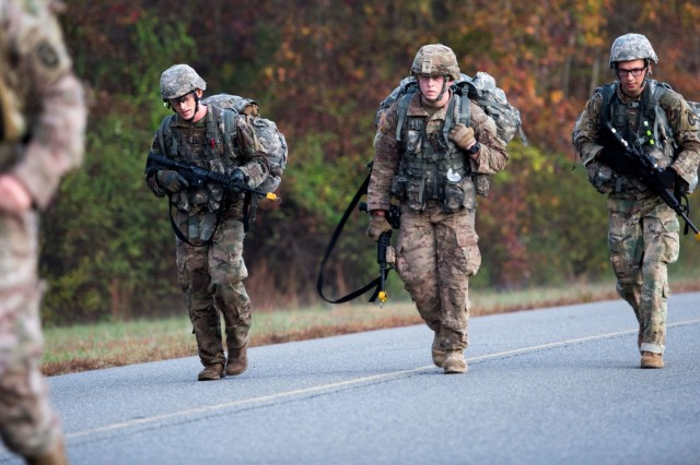 Soldiers with 3d U.S. Infantry Regiment (The Old Guard) complete a 12-mile foot march Nov. 3, 2017, at Fort A.P. Hill, Va., as part of a five-day evaluation for the coveted Expert Infantryman Badge.