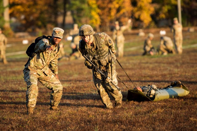 A Soldier with 3d U.S. Infantry Regiment (The Old Guard) completes a causality evacuation exercise as he attempts to earn the coveted Expert Infantryman Badge, Nov. 3, 2017, at Fort A.P. Hill, Va.